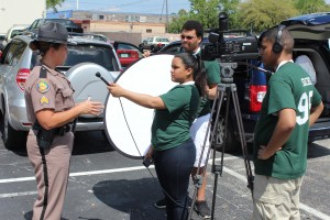 Stephanie Romero asks Sgt. Kim Montes of the Florida Highway Patrol about pedestrian safety on International Drive.