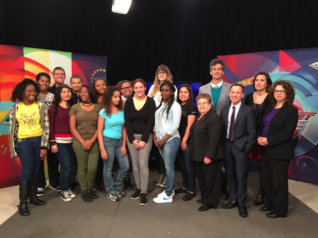 Truman students with experts after the Strike a Chord panel discussion show.  L to R: Quincee Tellis, Mike Ortiz, David Roush (teacher), Sully Alonzo, Sandro Rodriguez, Cleopatra Green, Messiah Banks, Hildanelys Minaya, Nicole Garcia, Rosannie Calderon, Allyee Whaley (Trevor Project), Tyiece Johnson, Daniella Dominguez, Dr. Rosa Gill (Communilife), Michael Max Knobbe (BronxNET), George Bodarky (WFUV), Marisa White (BronxNET), Jill Harkavy-Friedman (Am. Society for Suicide Prevention)