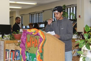 Freshman Miguel Alvarez grabs the mic during an emotional moment in his poem Wednesday.
