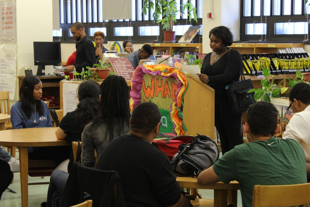 Kinara Joseph-Bolling commands the attention of an entire room of students as she reads her poem on Wednesday.