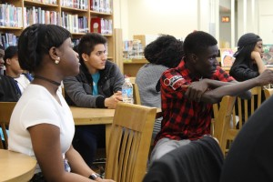 Students listen intently as classmates read their poetry in the Truman Library Wednesday.