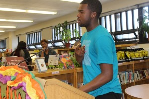 Tyrone Pinckney Jr. recites his poem for 5th period students on Wednesday.