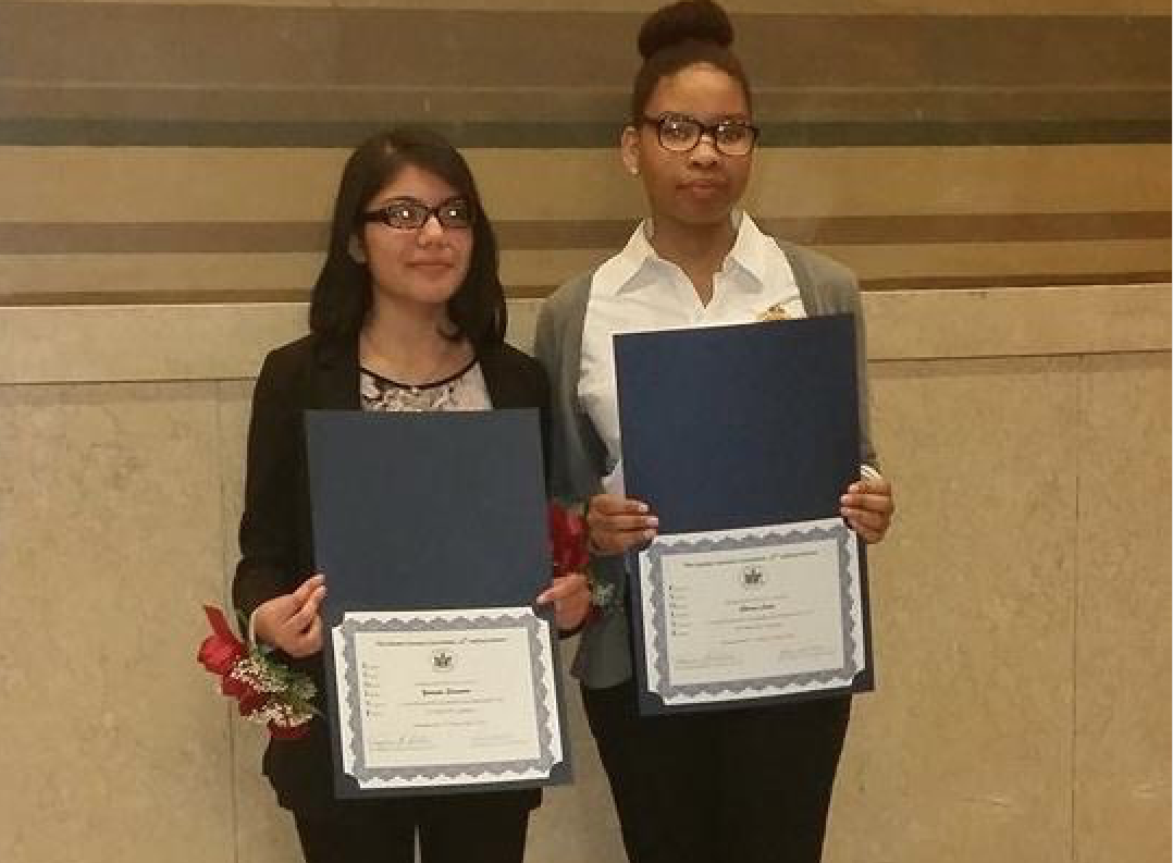 Yessenia Saavedra (l) and Sherece Laine are honored with the EVOLVE Award from the Bronx Supreme Court.