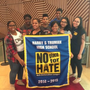 Ysabel, Doneika, Maridalia, Michael, Rene, Stevem, Andrea, and Heidy proudly pose with the 2014-2015 No Place For Hate banner.