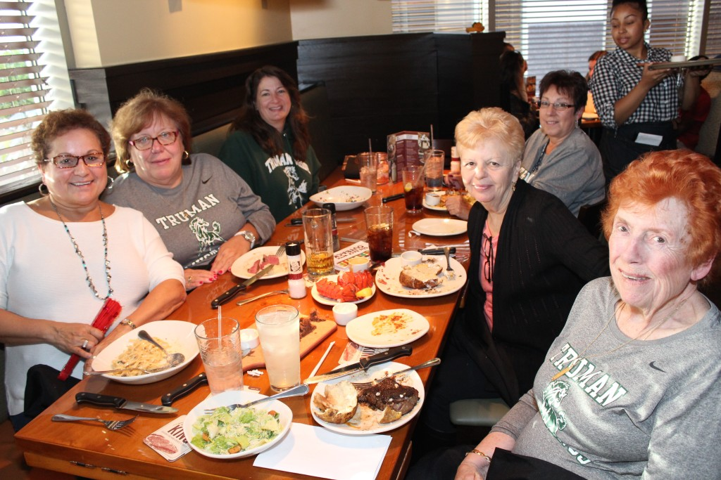 Secretaries and guidance counselors enjoyed a taste of the Outback at Monday's Give Back Night event.