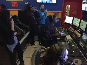 Students watch carefully as director Moziah Sterling and producer Alexa DePalma run the 11:30a.m. broadcast at News 12 the Bronx.