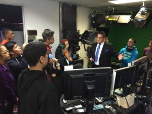 Students listen as Meteorologist Mike Favetta explains how the weather system works at News 12.
