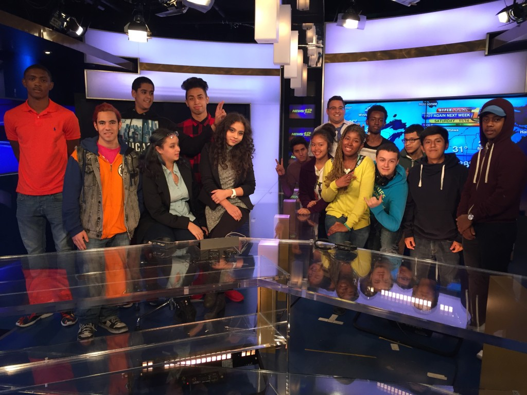 Students from the Truman Media Program pose for a photo in the News 12 studios.