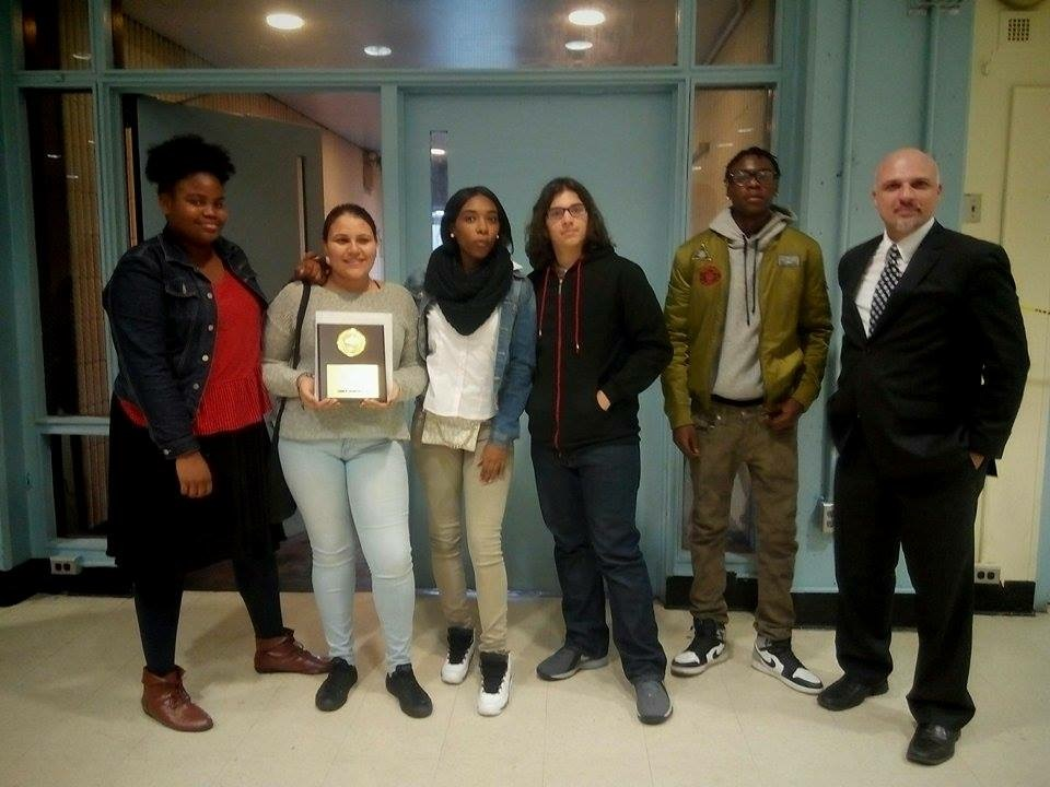 "Several law students, with teacher Mr. Zanoni show off the plaque they earned at December's ""We The People"" competition in Manhattan."