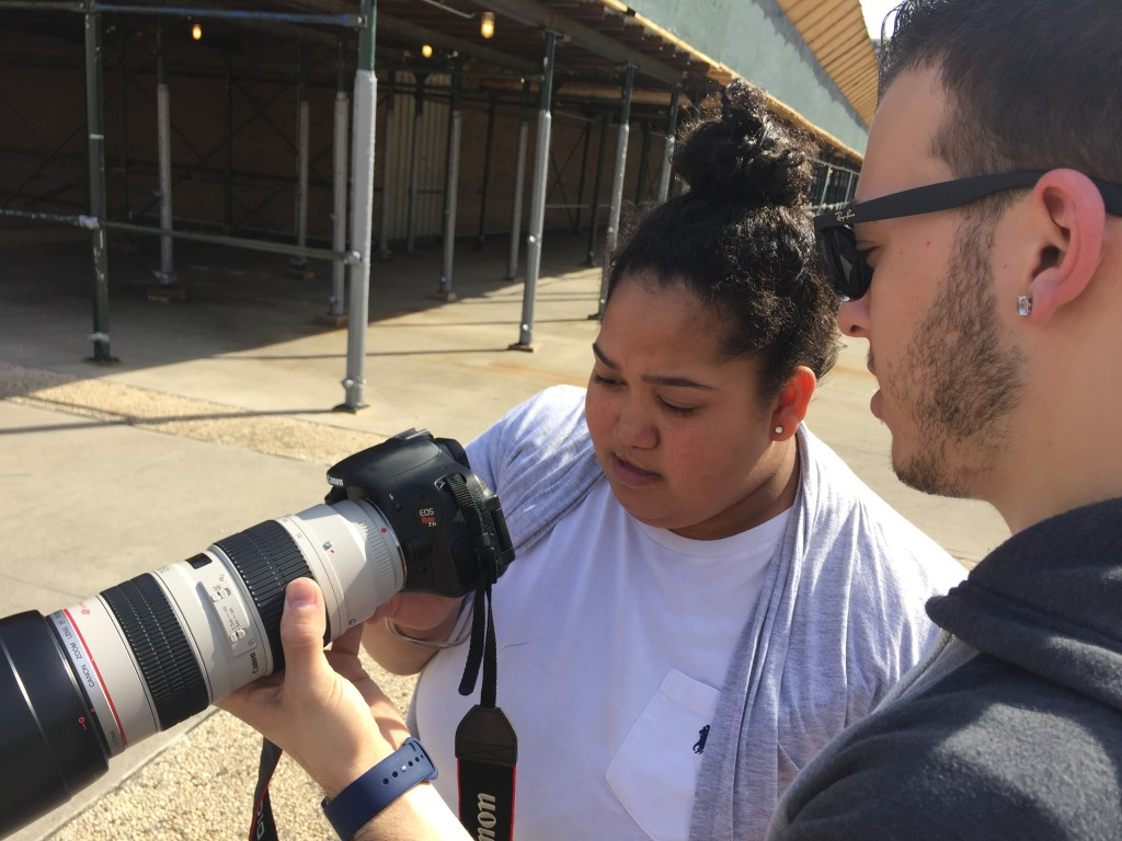 Tom Russo looks at a shot taken by media junior Eliza Perez.