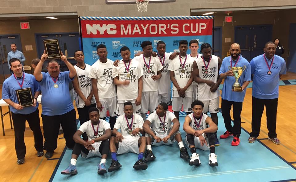 Kevin Dennis (back row, third from right) and Coach Ricardo Furriel (back row, far left) celebrate winning the NYC Mayor's Cup Championship. Kevin was the MVP, scoring 24 points overall.