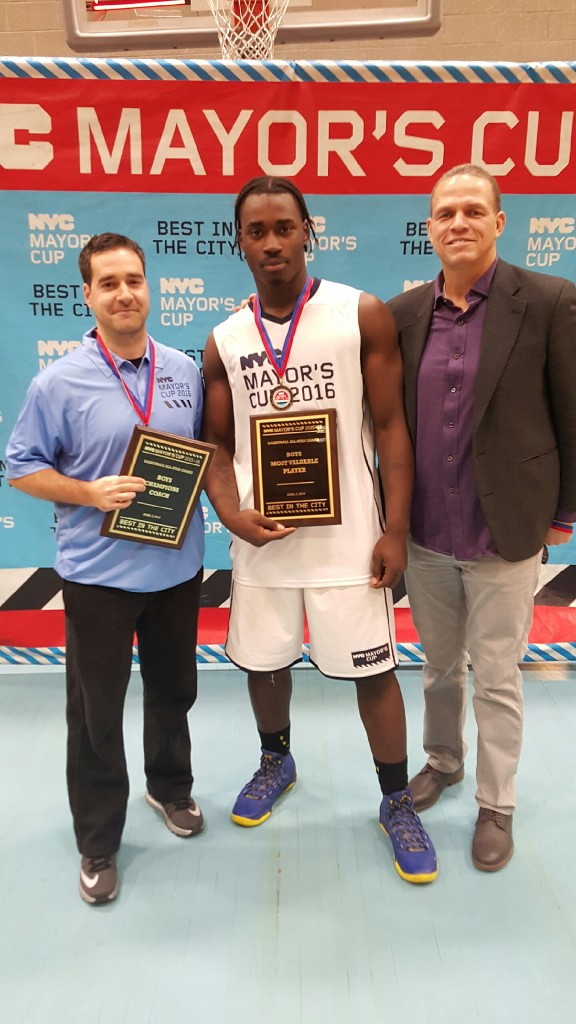 (l to r) Coach Ricardo Furriel, Senior Kevin Dennis and PSAL Sports Coordinator Danny Harris celebrate Dennis receiving MVP honors at the Mayor's Cup Game