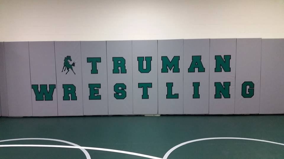 New wall pads in the Mustang wrestling room. (Photo: Ted Cook)