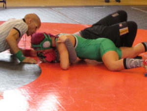 Junior Pearl Fletcher puts her opponent in a tough position at a recent wrestling match.