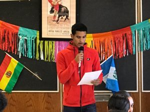 Junior Miguel Alvarez takes the mic at the October Hispanic Heritage event.