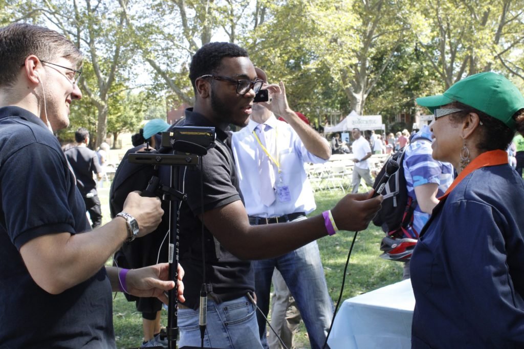 Lester Robinson interviews a visitor at the Vendy Awards on Governor's Island in September.