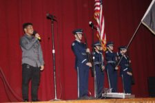 Fred Huertas opens the show with the National Anthem, along side the Air Force JROTC color guard.